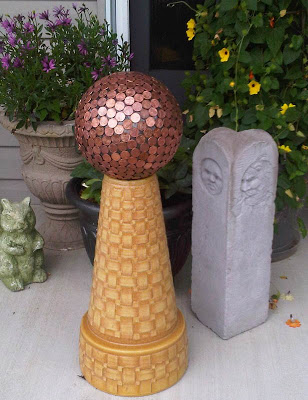 How to make a penny bowling ball, fun and unique yard art for your garden. And some people say the copper pennies repel slugs!