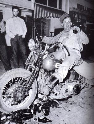 man riding vintage motorcycle