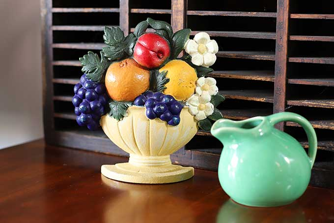 Fruit basket doorstop by John Wright