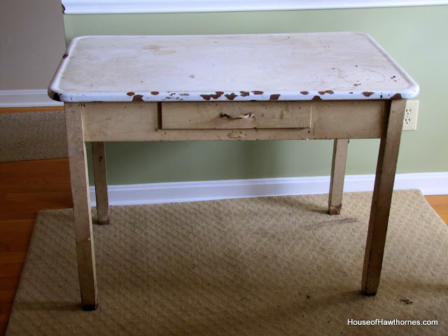 A vintage enamel top table doubles as a potting table or bench.
