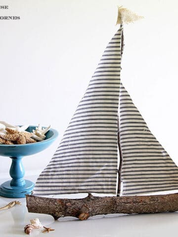 Sailboat made from twigs and scrap fabric.