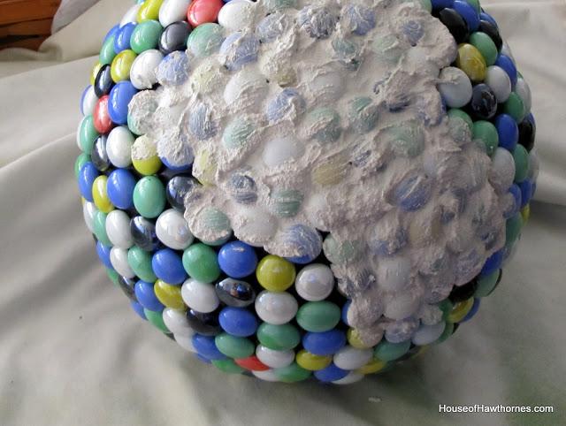 DIY fun yard art for your garden made from a bowling ball from houseofhawthornes.com
