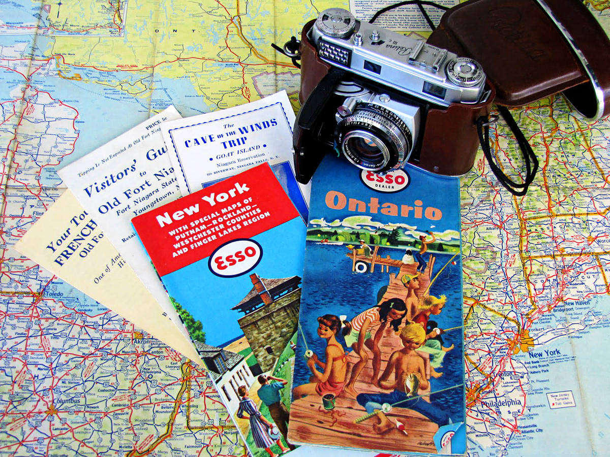image of vintage travel maps and vintage camera