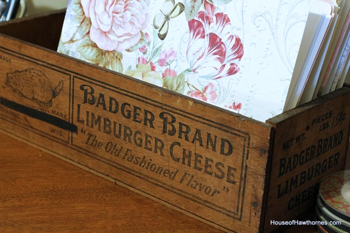 Badger brand wooden cheesebox used as a file holder.