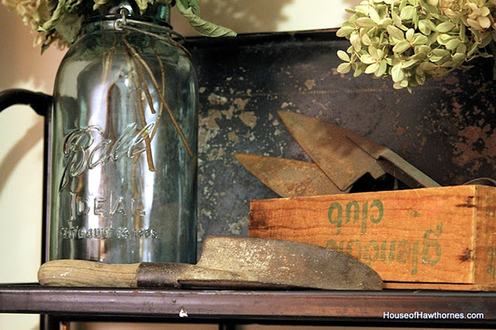Blue mason jar setting on a shelf.