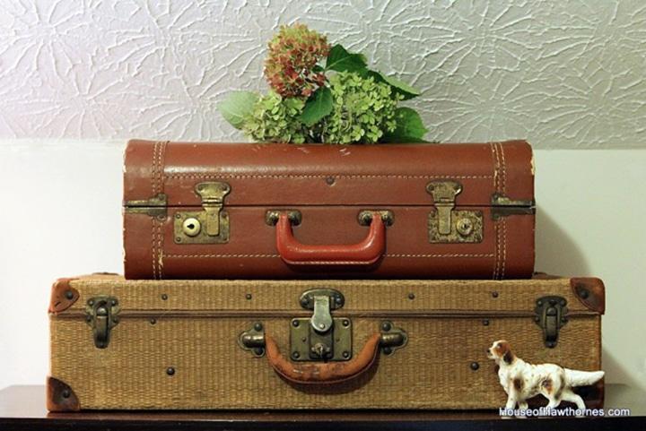 Vintage suitcases used as office storage.