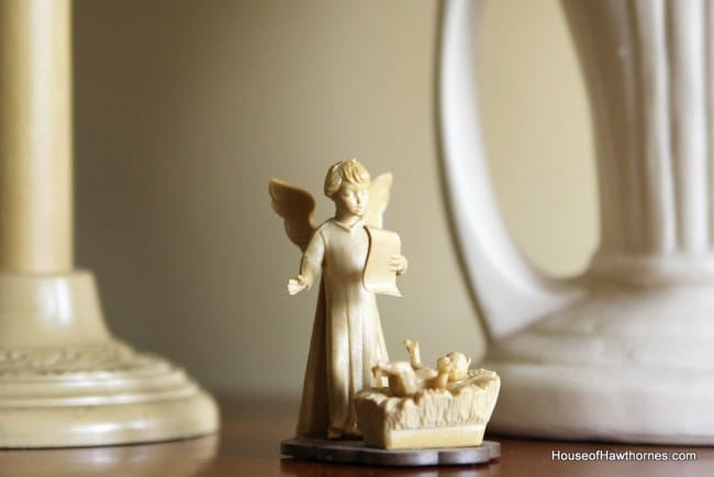 Small nativity set used in a vintage Christmas display along with a Royal typewriter