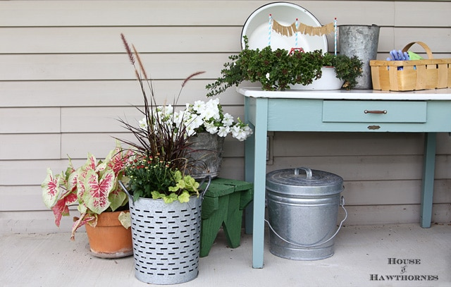 Shows you how to trade out a few plants in your summer container gardens to take them into the fall season in style!