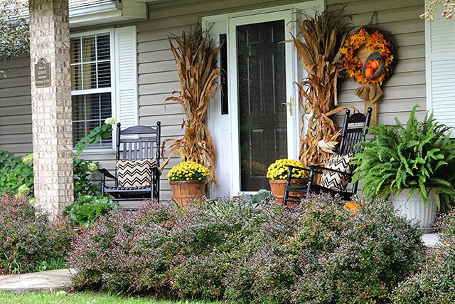 Fall porch decor with cornstalks, DIY wreath, and chevron pillows @ houseofhawthornes.com