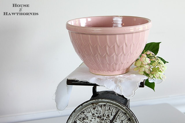Vintage pink McCoy mixing bowl with fish scale petal feather pattern