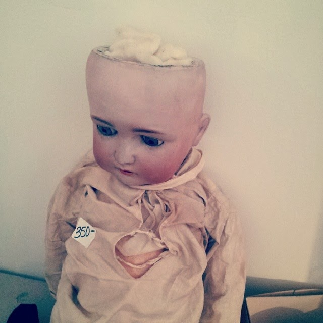 Scary doll missing part of her head