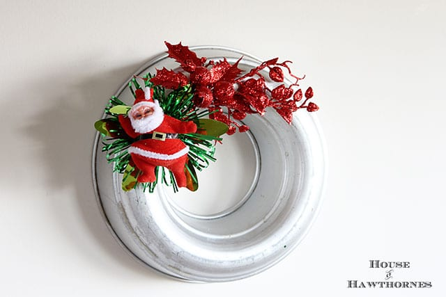 Kitschy vintage styled Christmas wreaths made from jello molds and faux vintage corsages. Sort of like the Christmas corsages your Grandma used to wear to church on Christmas Eve.