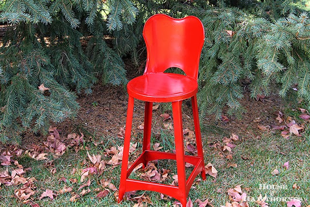 Vintage metal child's chair painted red for the holidays