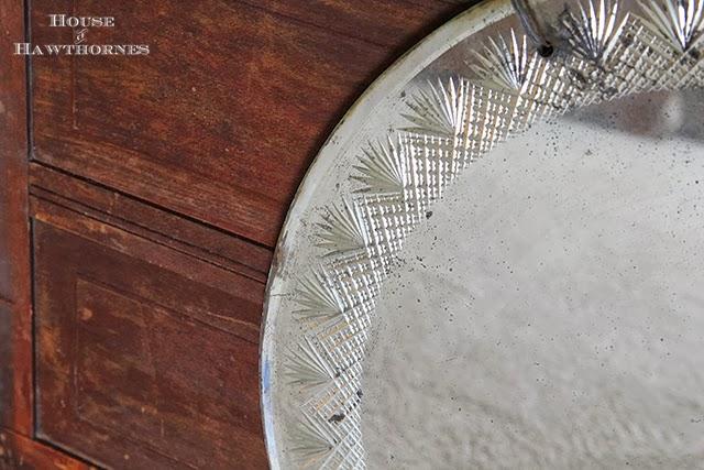 Round mirror with pretty etching around the perimeter found at an estate sale