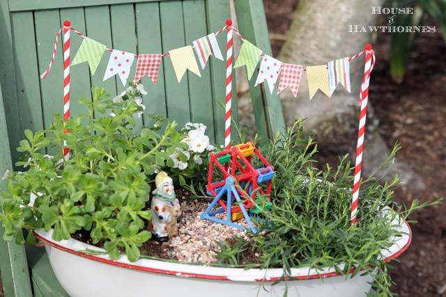 A super cute DIY circus themed fairy garden. Non scary clown included :)