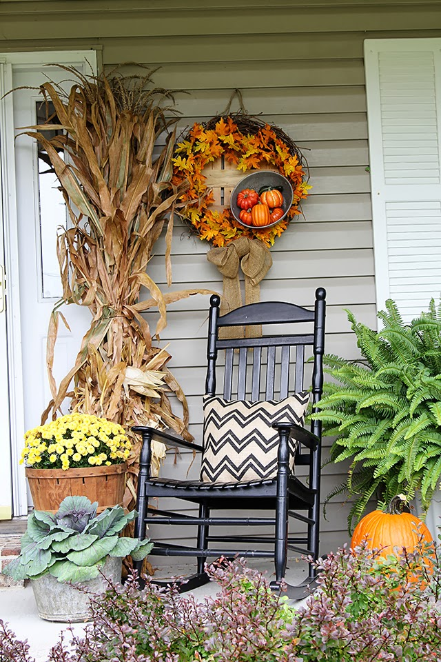 Cornstalks and chrysanthemums for traditional outdoor fall decorations.