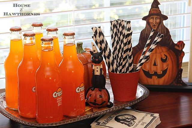 Vintage style Halloween party decor with blow molds and honeycombs