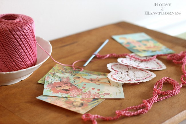 Valentine garland made with paper doily hearts, vintage Valentine printables and  crochet thread