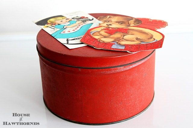 Rusty red tin with vintage Valentines.