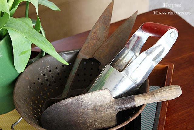 Rusty vintage gardening tools used in a spring vignette