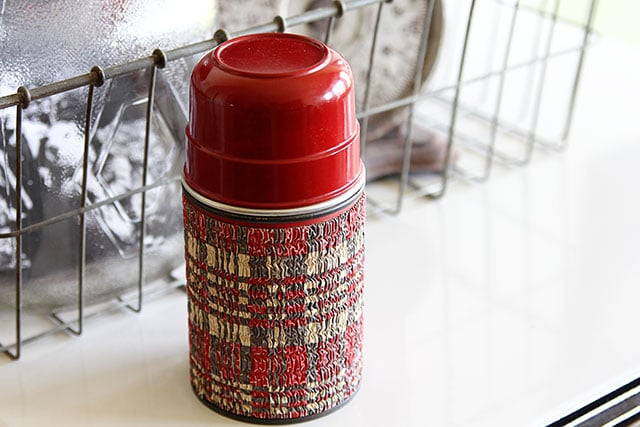 Vintage plaid Aladdin thermos with a cork stopper