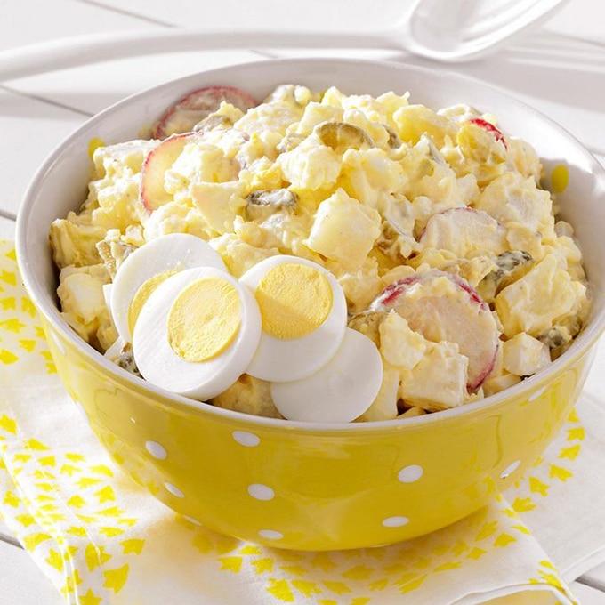Deli style potato salad with eggs and sliced radish