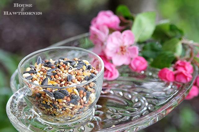 Vintage glass snack set repurposed into a bird feeder