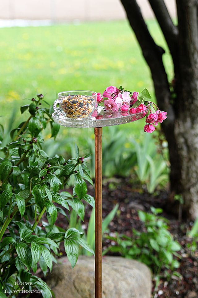 Vintage glass snack set repurposed into a bird feeder