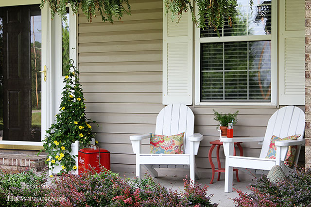 A fun summer porch with a bit of vintage decor