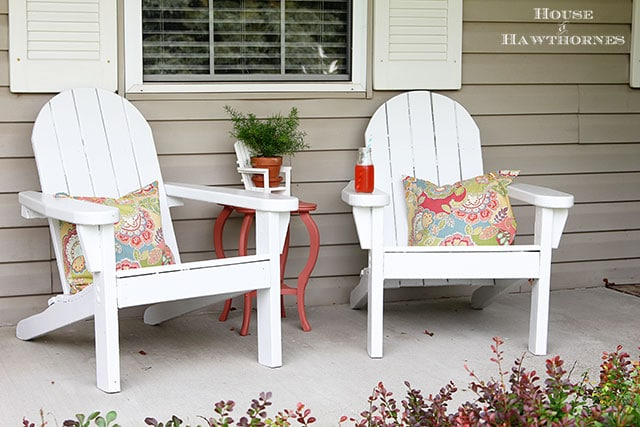 Adirondack chairs on a fun summer porch with a bit of vintage decor