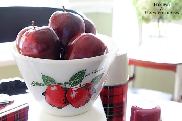 Vintage Fire King apple bowl is part of a fall apple vignette for the kitchen table via houseofhawthornes.com