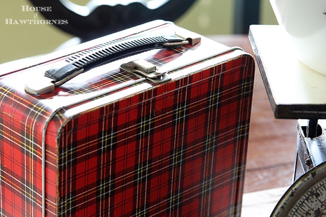 1960's Aladdin plaid lunchbox is part of a fall apple vignette for the kitchen table via houseofhawthornes.com