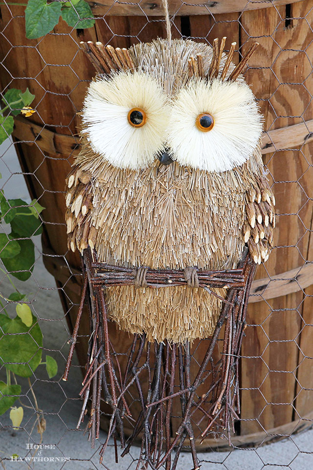 LOTS of fall porch ideas and inspiration including this rustic framed owl. Your porch is the first impression people get of your home, so make it a festive one! Whether you love traditional, farmhouse or eclectic decor you'll find inspiration through this girl's festive and unique look back at her fall porch decor over the years!