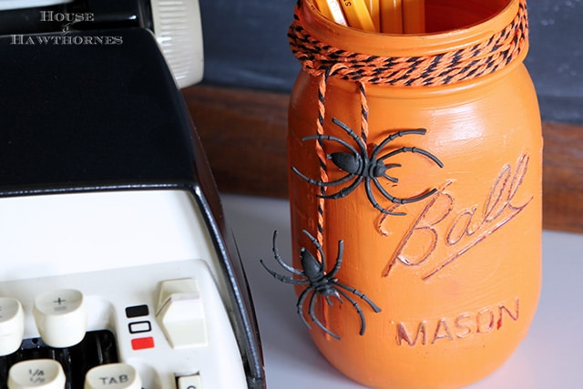 Halloween Painted Mason Jar Craft - a fun five minute craft for fall. via houseofhawthornes.com
