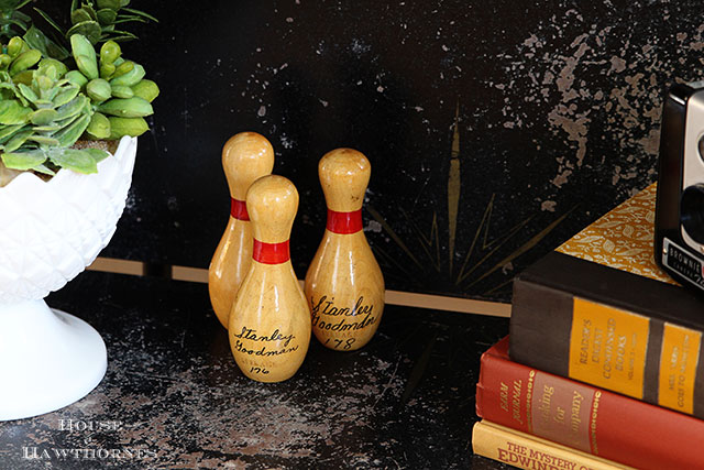 Mini bowling pins in an eclectic vintage entryway via houseofhawthornes.com