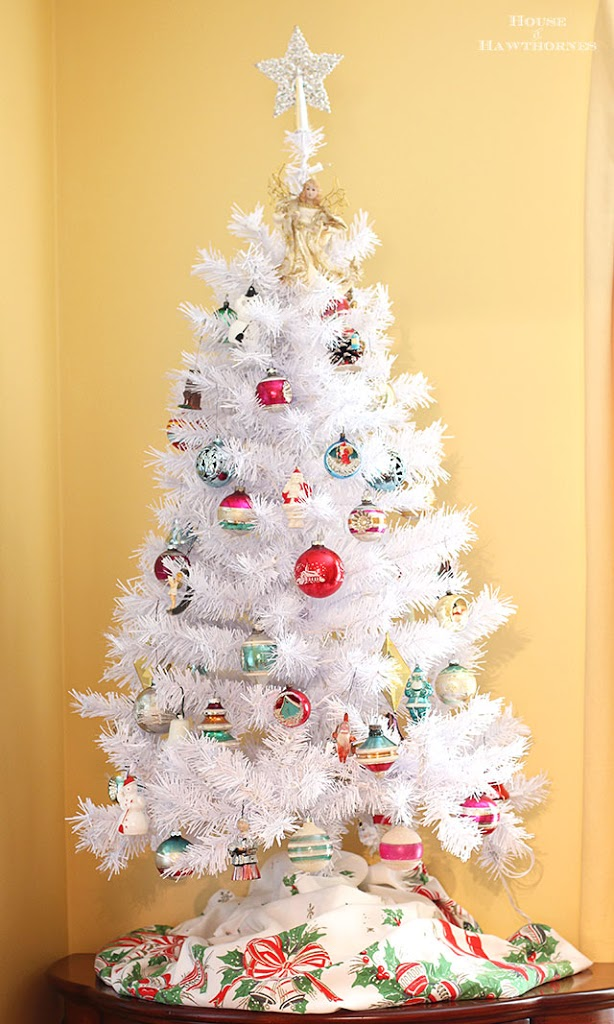 a white christmas tree with vintage shiny brite ornaments creates a modern retro holiday look that