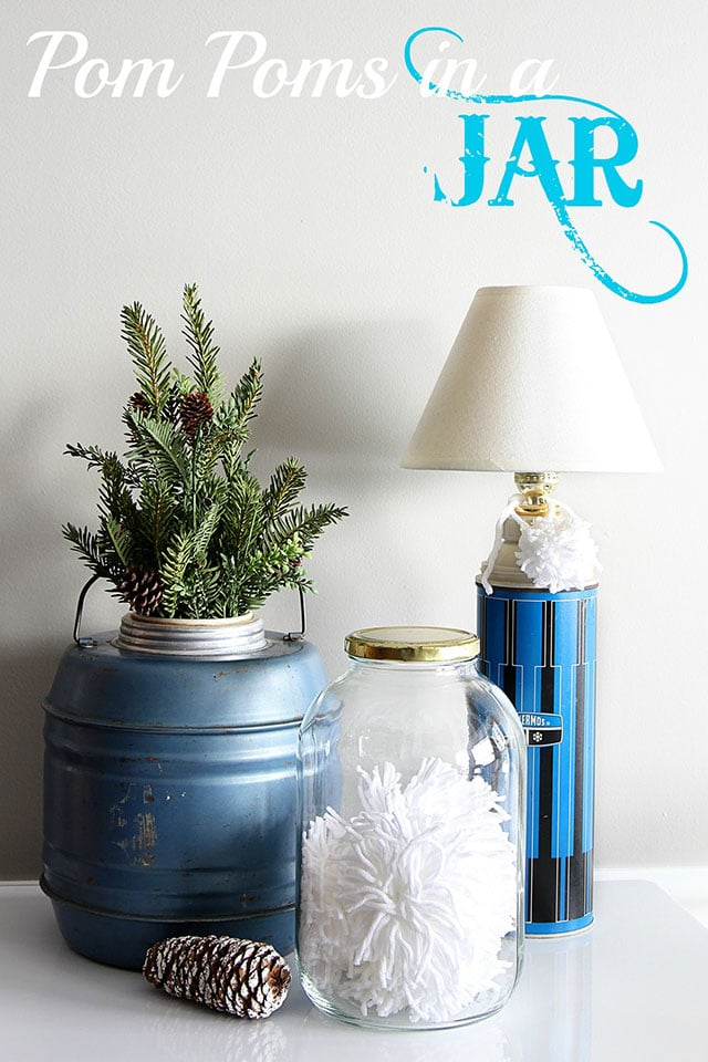 DIY pom poms in a glass jar - for those that don't want to make enough of them for an entire Anthropologie inspired tufted wool wreath.