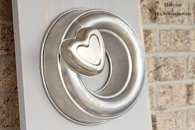 Repurposing some common items you may have around the house into a fun and funky DIY wooden LOVE sign for Valentine's Day. Would be a great craft for rustic wedding decor also.