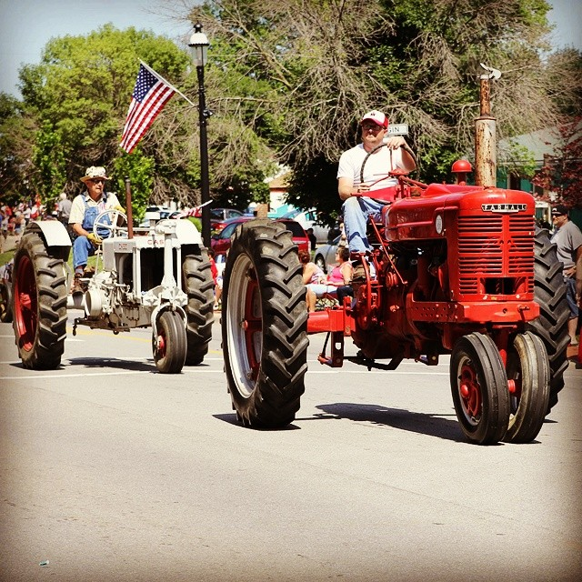 Tractors in a Midwestern 4th of July parade