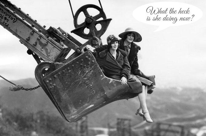 Vintage photo of girls sitting in construction crane