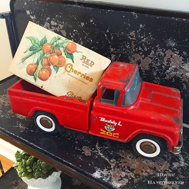Vintage box of chocolate covered cherries in a toy Buddy L truck