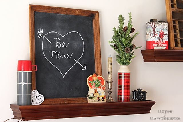 Valentine's Day chalkboard vignette with a Thermos theme and a vintage lumberjack classroom valentine