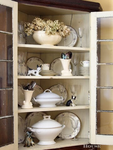 Corner cupboard filled with ironstone