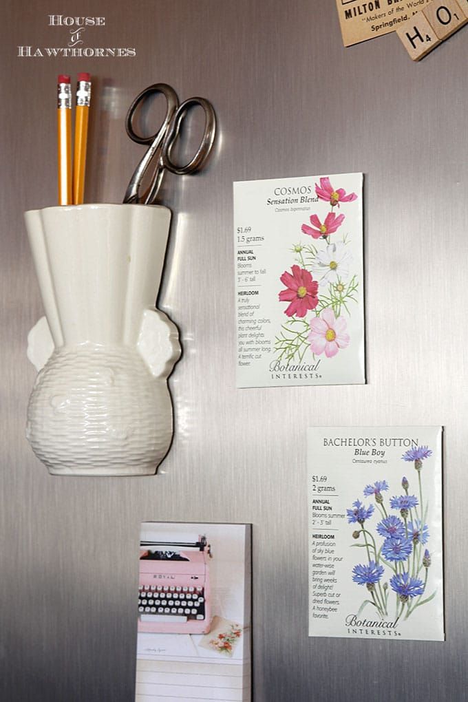 DIY seed packet refrigerator magnets to bring a little spring to your home decor. A super quick and easy 5 minute craft project.