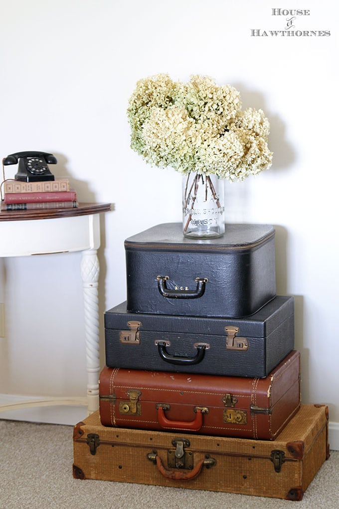 Farmhouse storage ideas to give you the farmhouse look and organize your life at the same time. Vintage suitcases, picnic baskets, toolboxes and more.