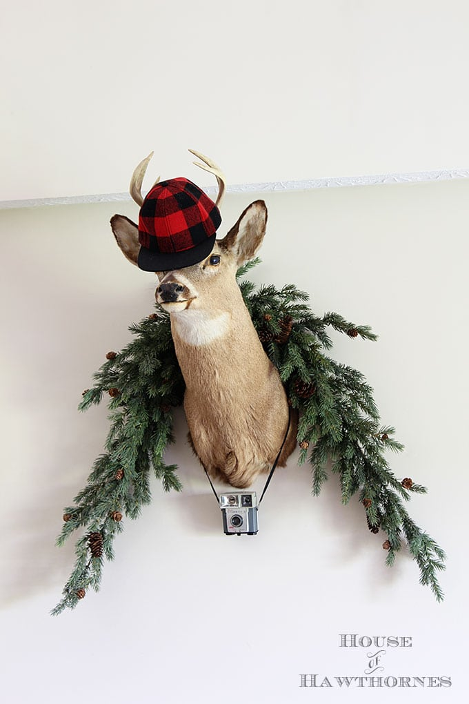 Buffalo check hat being worn by a Christmas deer