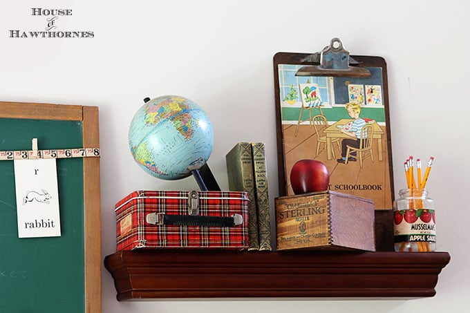 Back to school vignette with a vintage globe and plaid lunchbox