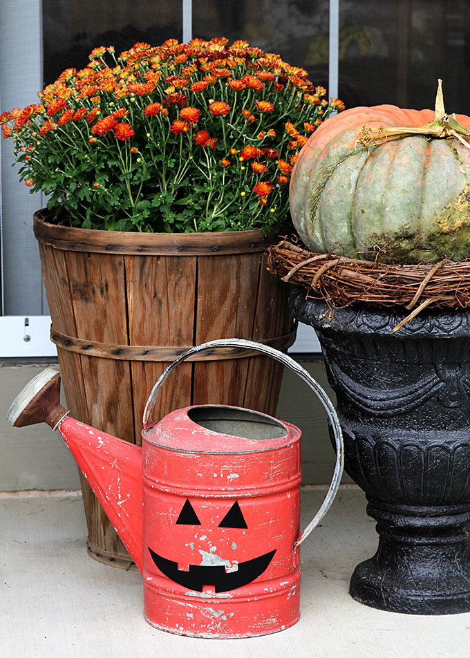 A super cute repurposed Jack-o-Lantern for Halloween made from a galvanized funnel.  A quick and easy DIY project for fall!