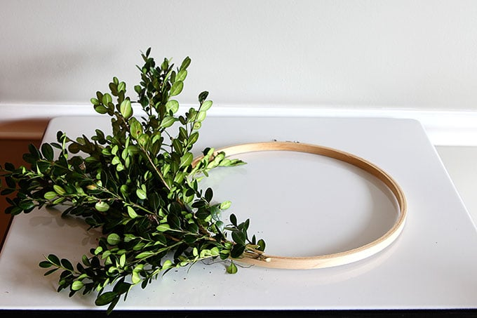 Learn how to make a super quick and easy boxwood wreath. And did I mention it is cheap?  Perfect for the holidays, yet looks great any time of the year.