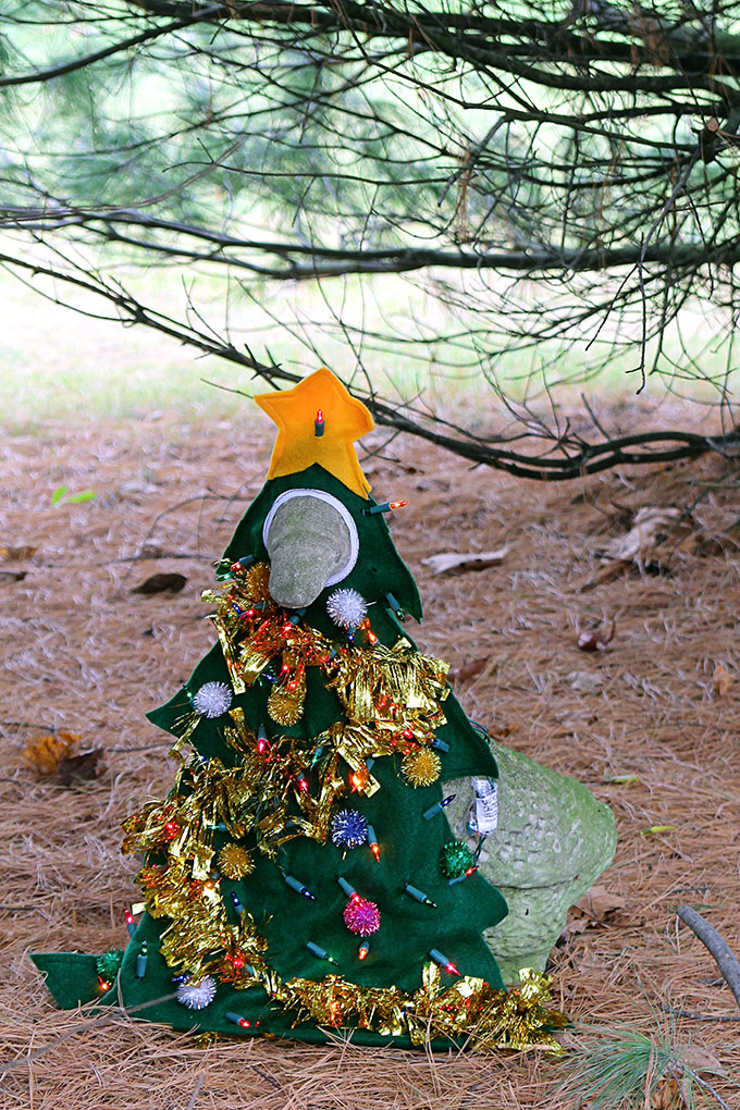 A 1990's concrete lawn goose dressed up as a Christmas tree for the holidays. Oh yeah, it's lighted. Does it get any tackier than this?